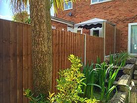Cocrete posts, wooden fencing in Barnehurst.