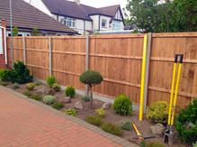 The rear side of close board fence panels.