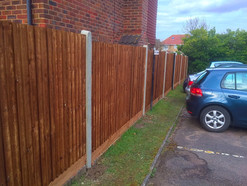 A run of feather edge fencing.