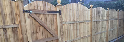 Luxury arch top timber fencing installed in Bexley Village.