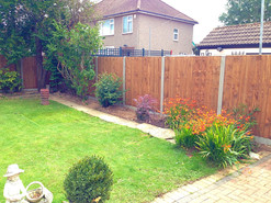5ft 6in Closeboard panels with concrete posts and concrete gravel boards.