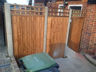 Close board fence panels with trellis.