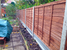Waney lap panel fencing.