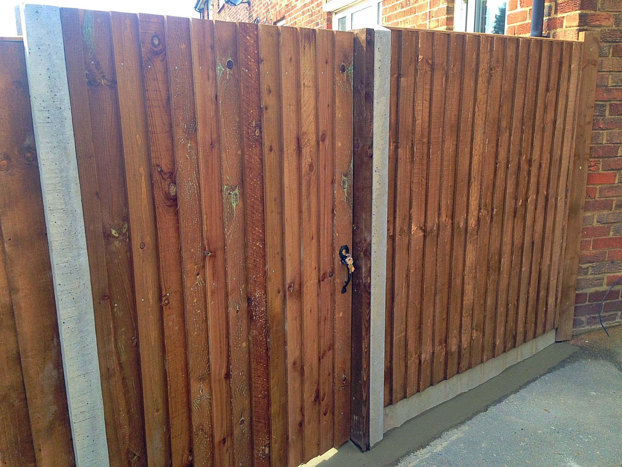 Single gate and close board fence.