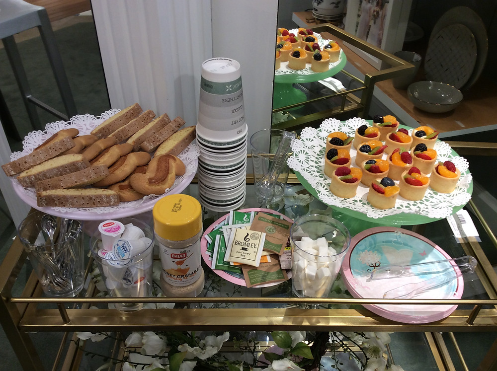 food and tea on a bar cart