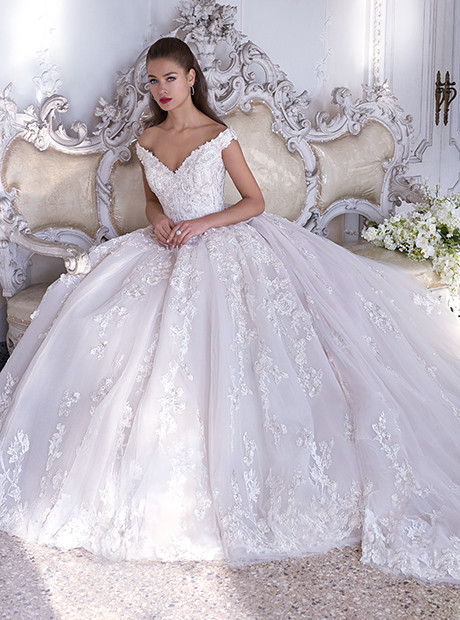 bride wearing lace and organza ball gown dress