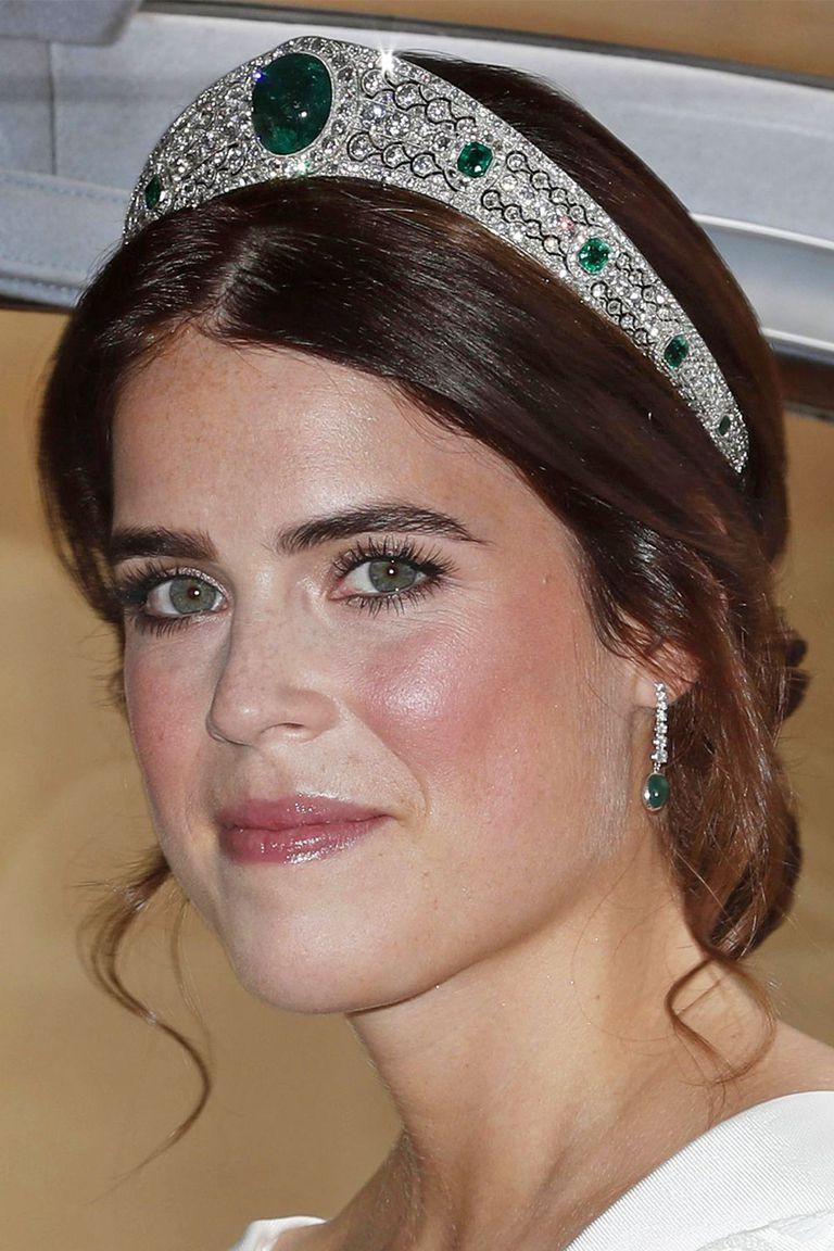 young woman wearing an emerald green tiara and wedding dress