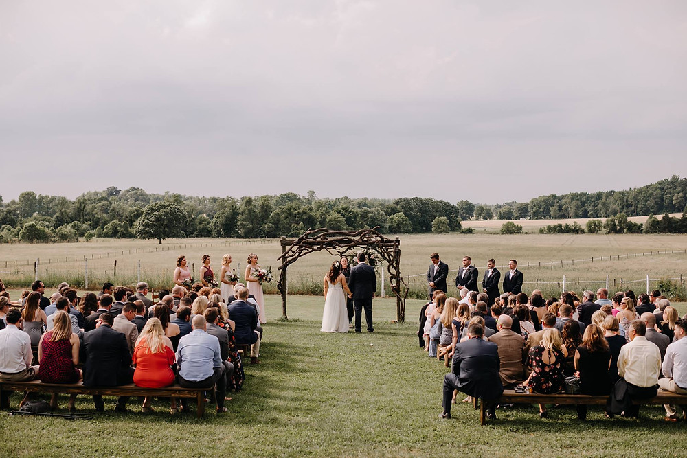 outdoor wedding with bride, groom and guests