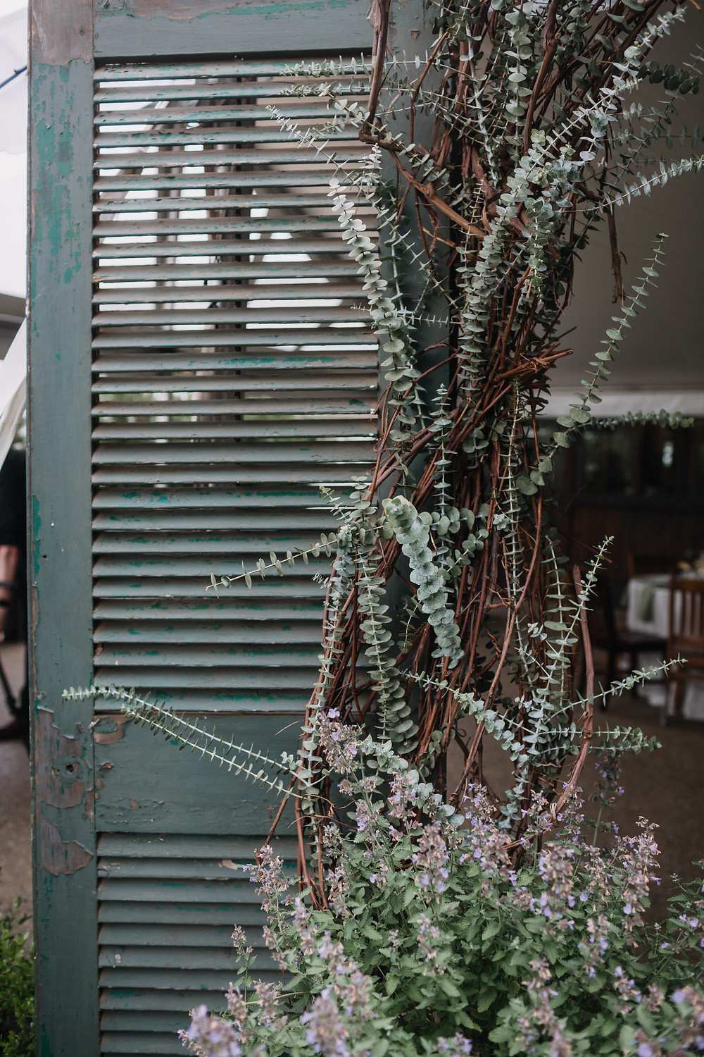 painted wooden shutter decorated with florals