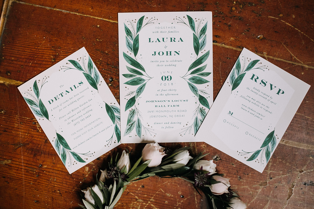 wedding invitation suite with forals and greenery