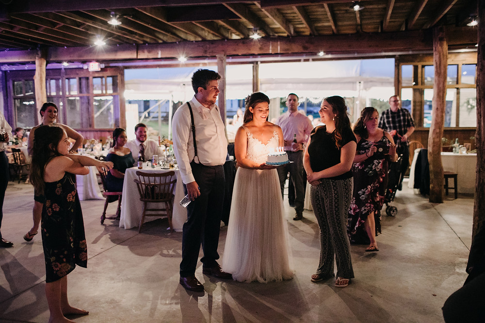 couple at wedding reception with birthday cake