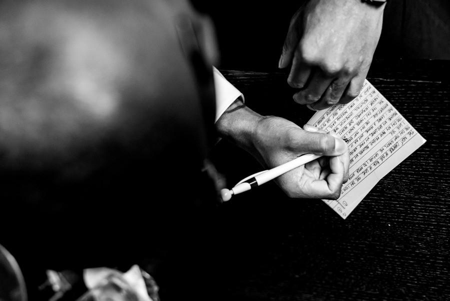 Groom writing wedding vows