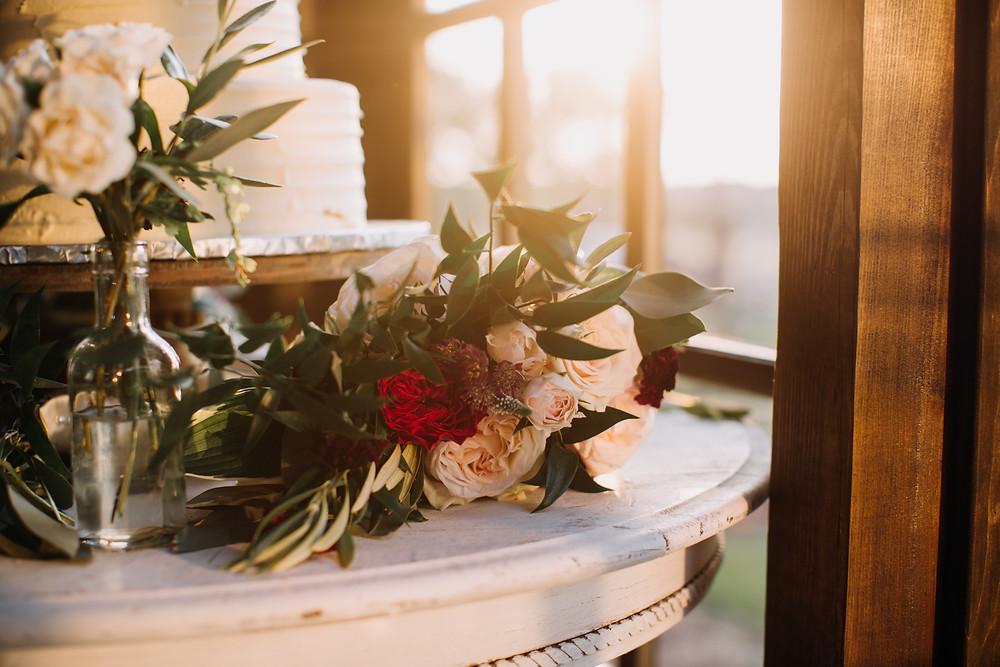 wedding cake with fresh flowers in sunlight
