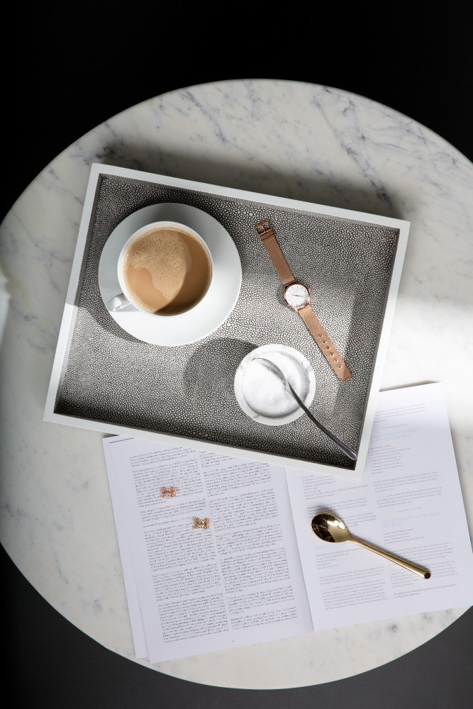 tray with a cup of coffee and watch