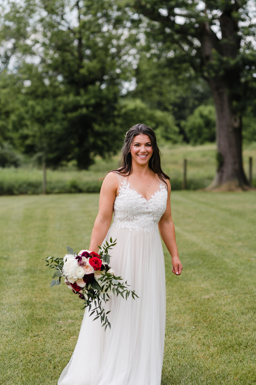 bride wearing wedding dress and carrying bouquet of flowers
