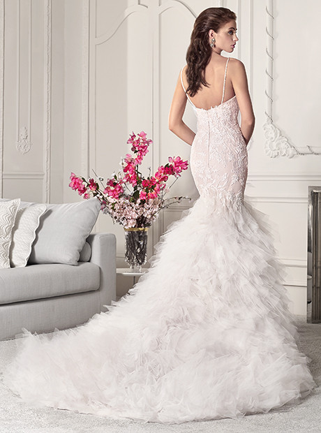 wedding dress with spaghetti straps, lace and ruffled train.