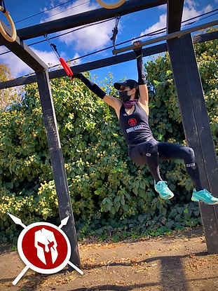 Spartan athlete conquering the MPS multi-rig obstacle.