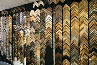 A Wall with Gold & Silver Framing Molding Samples