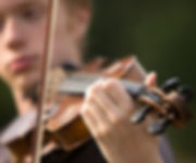 Young aritist playing violin