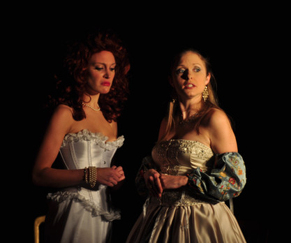 Nell Gwynne (Romily Turner) and Veronica Franco (Emma-Kate Baxter) share a secret in 'Five Clever Courtesans'