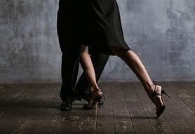 young-pretty-woman-black-dress-man-dance