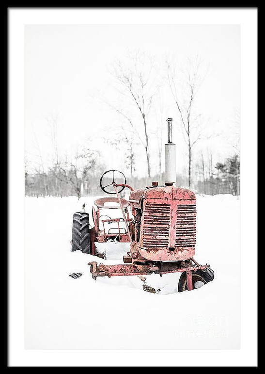 Old Vintage Red Tractor in the Snow