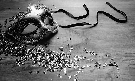 venetian-carnival-mask-with-sequins-wooden-desk_edited.jpg