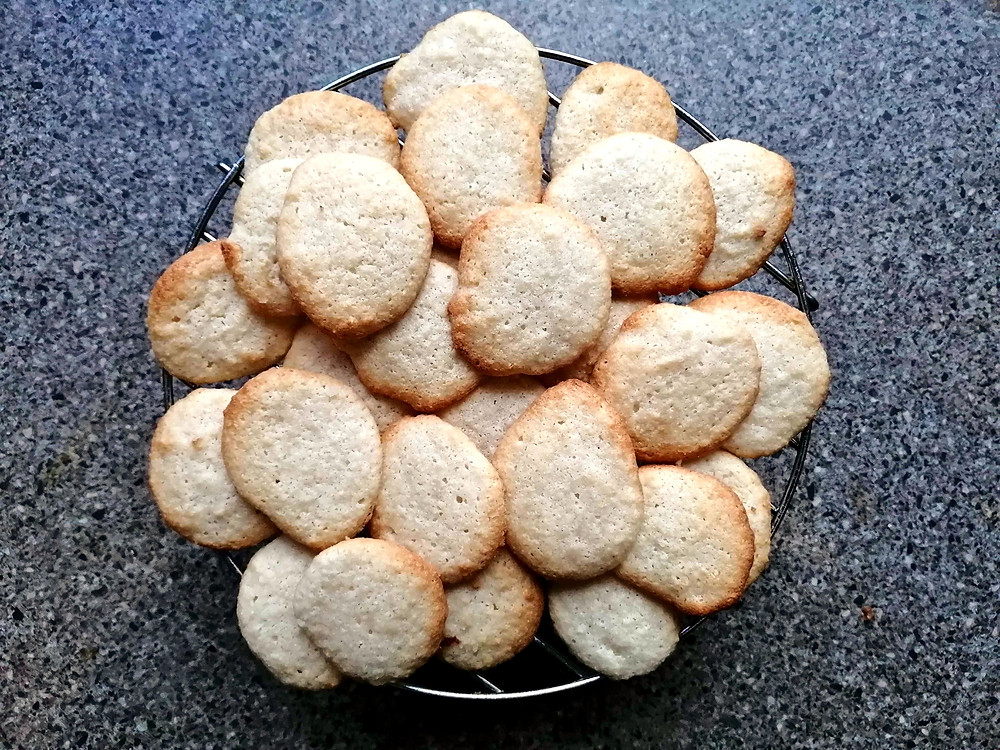 Drunk Almond cookies on a cooling rack