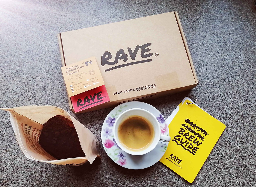 rave coffee subscription box with fresh cup of coffee