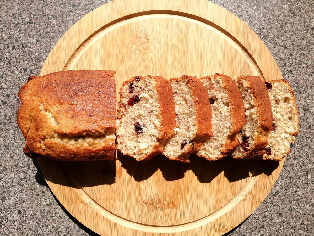 coconut and cranberry banana bread sliced loaf