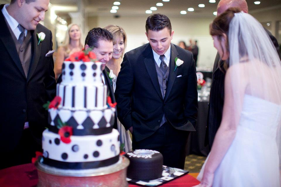 Admiring the groom's cake.