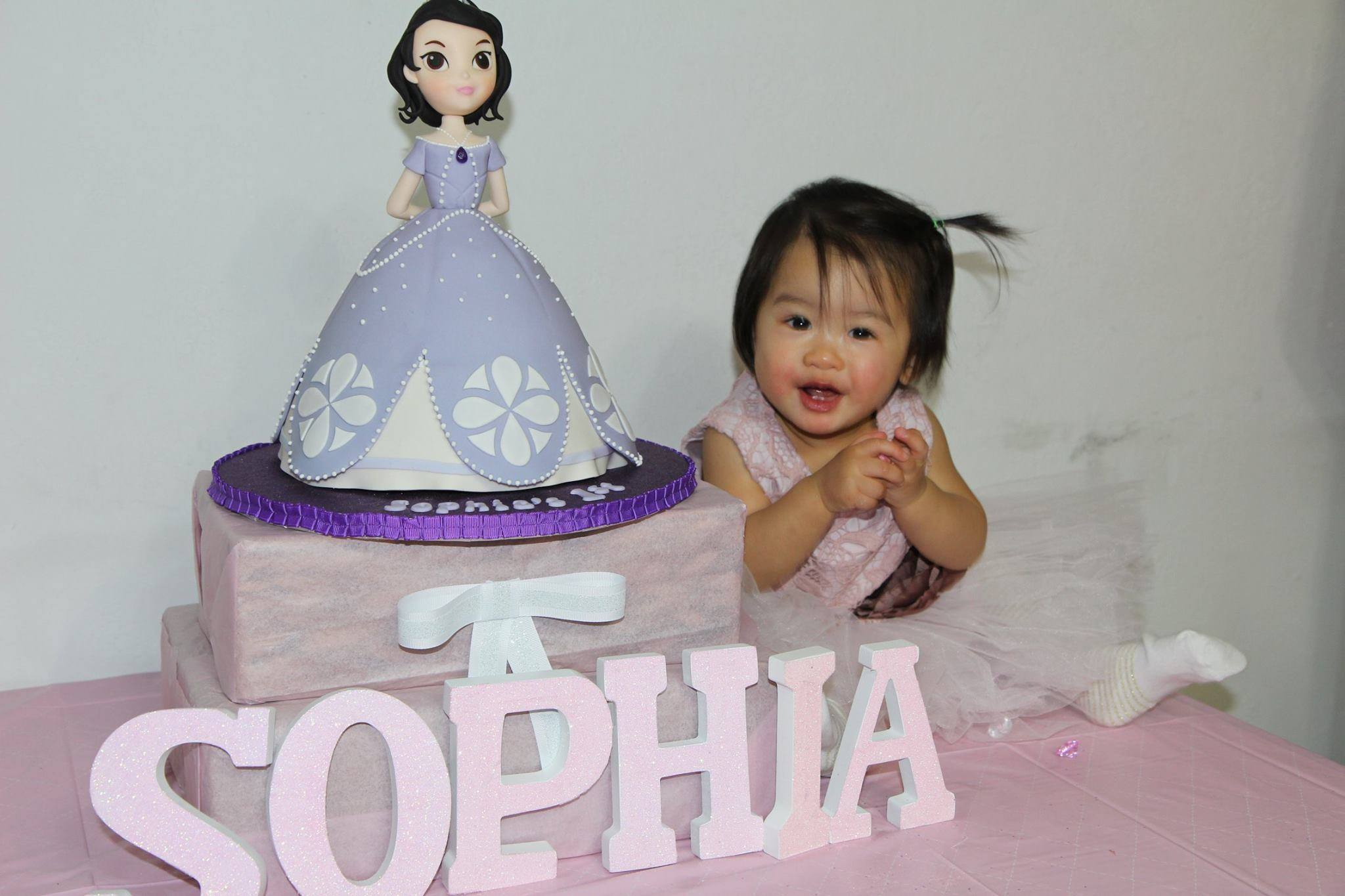 Sophia with her Sofia cake.
