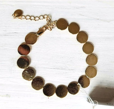 Textured discs bracelet in silver or gold