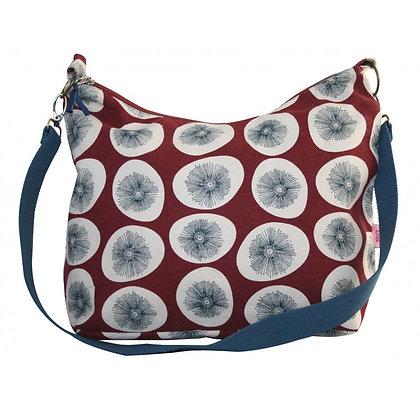 Dandelion sling bag in burgundy