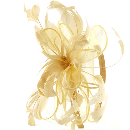 Pale yellow fascinator on band