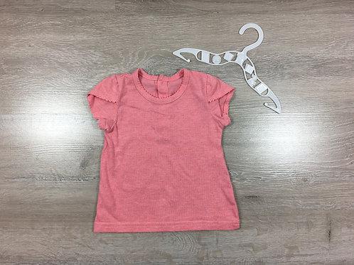 T-shirt com pequenina mancha