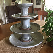 Pottery Pedestal Plates shown on top of Serving Plate