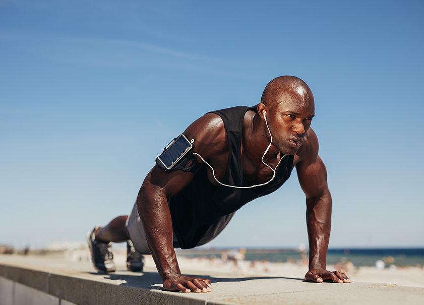 young-athletic-man-doing-push-ups-PYVWGU