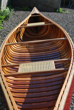 Wood and canvas canoe