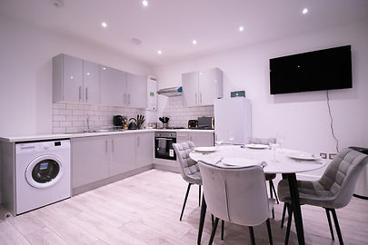An open plan kitchen dining in an accommodation in Farnborough