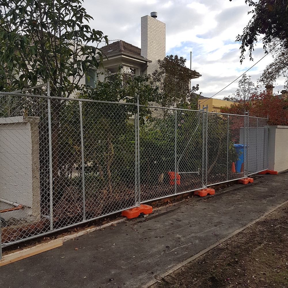 Temp fence setup on boundary to replace brick fence