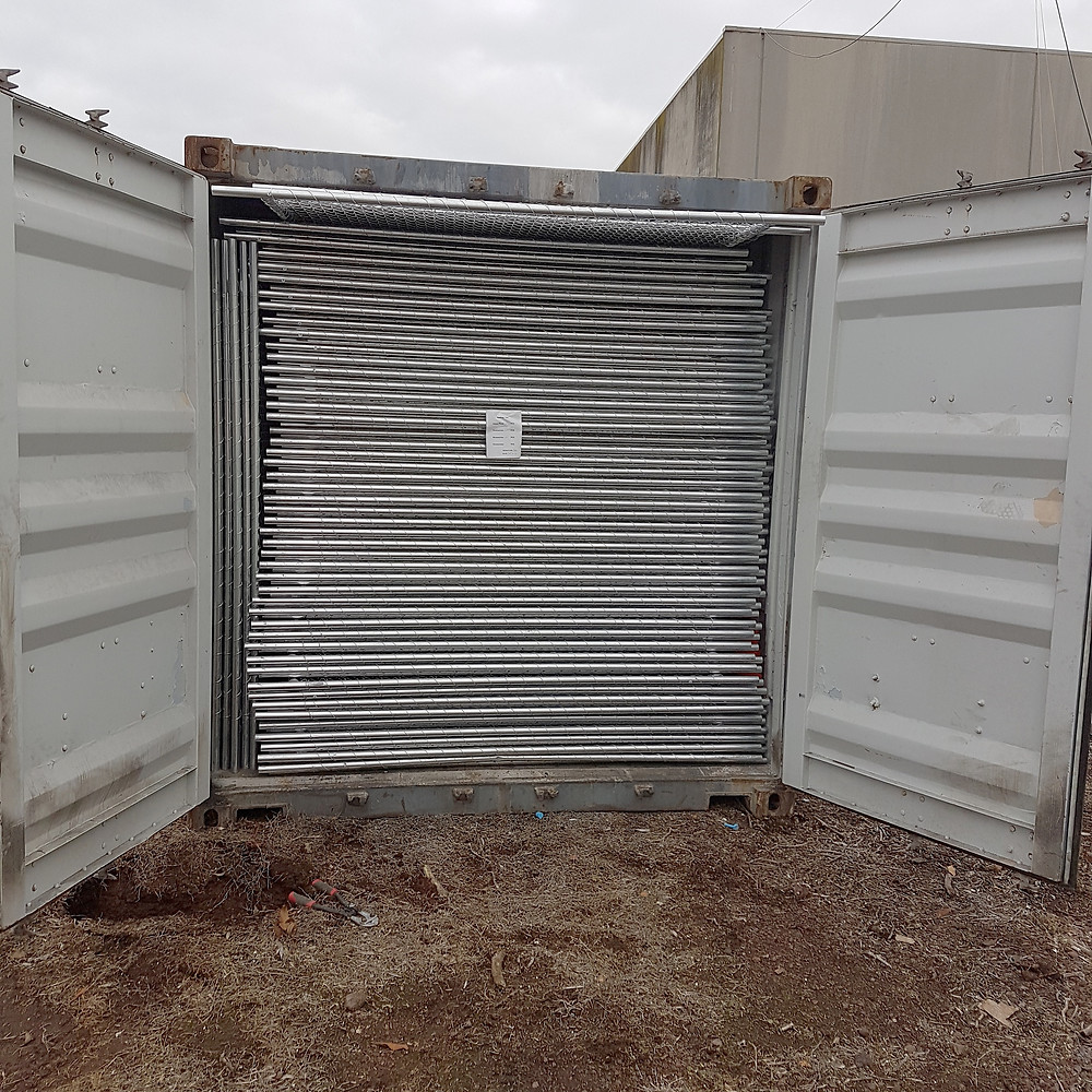A container of brand new temp fence ready for hire