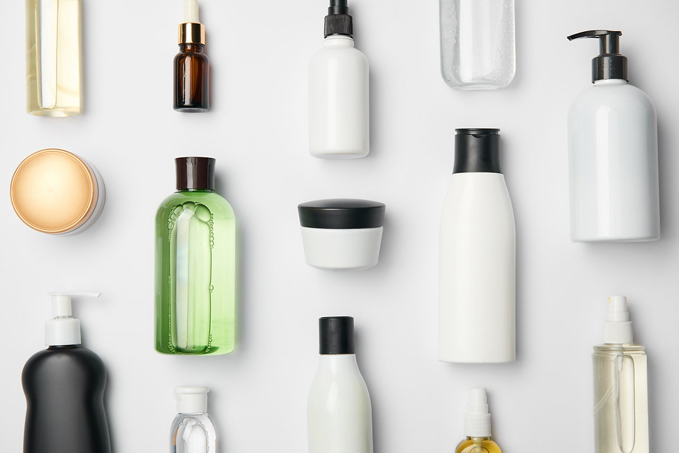 Top view of different cosmetic bottles a
