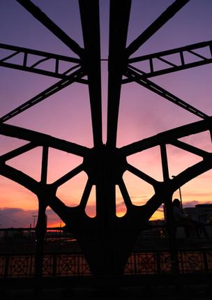 Steel bridge architecture in sunset
