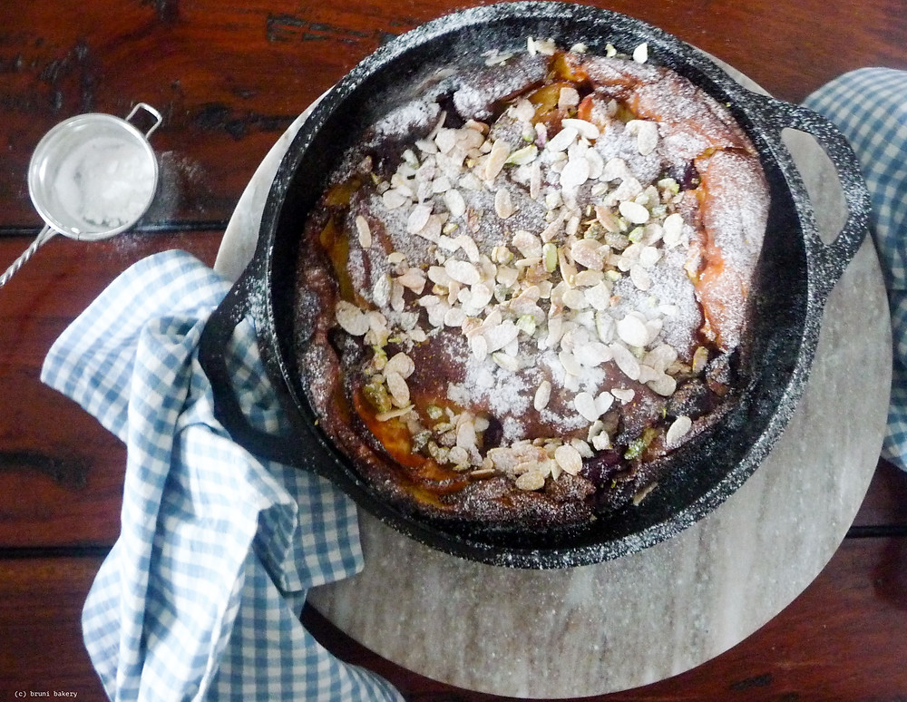 Cherry and Apple Dutch Baby with Toasted Nuts
