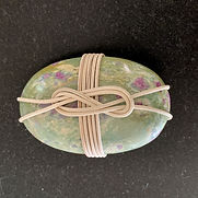 ruby kyanite fuschite wrapped rock front