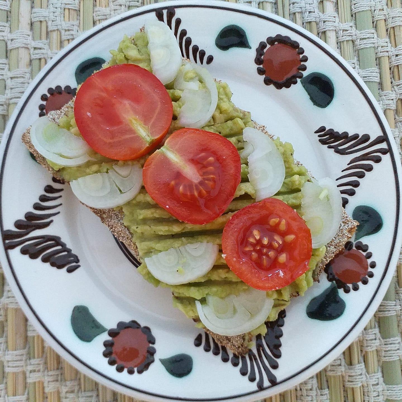 Bruschettas with avocado and cherry toma