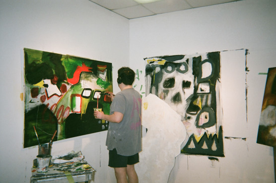 Alex with multiple paintings on the go
