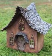 Large faiy house with shingled roof