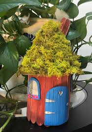 Pretty little small fairy house with a moss roof